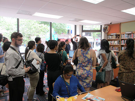 Photo of tour group standing in the library.