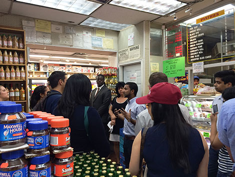 Photo of tour group standing in a supermarket.